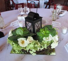 Birch Wreath Centerpiece with Green Hydrangea, Ivory Spray Roses, Ornamental Kale and a Lighted Lantern
