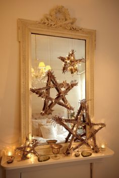 Rustic star accessories and strategically placed tealights for a classy Christmas mantel