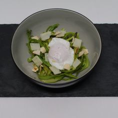 WILD ASPARAGUS SPAGHETTI WITH POACHED EGGS, MANCHEGO, GARLIC AND ALMONDS