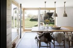 Paul Cashin Architects creates timber extension for coastal Island Cottage Larch Cladding, Timber Windows, Timber Structure, Old Cottage, Ground Floor Plan, Indoor Outdoor Living, Contemporary Architecture, House Architecture, Wood Table