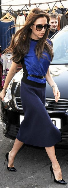 Victoria Beckham: Skirt and top – Victoria Beckham Collection    Shoes – Manolo Blahnik