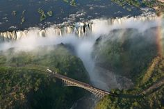 One of the most amazing places I've ever been. Victoria falls a waterfall 355 feet high on the Zambezi River, on Zimbabwe - Zambia border. Most Romantic Places, Beautiful Places, Amazing Places, Amazing Things, Beautiful People, Beautiful Pictures, Places To Travel, Places To See, Chutes Victoria