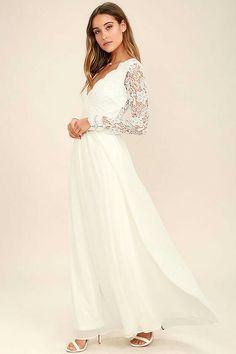 $84.00 Lulu https://www.lulus.com/products/awaken-my-love-white-long-sleeve-lace-maxi-dress/390882.html
