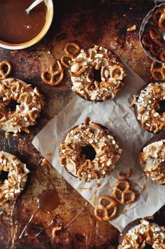 Baked chocolate doughnuts topped with salted caramel icing and chopped salty pretzels. These Baked Salted Caramel Chocoalte Doughnuts are a dessert dream!