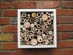 Garden art that doubles as a hotel for nesting bees, spiders, and beetles.