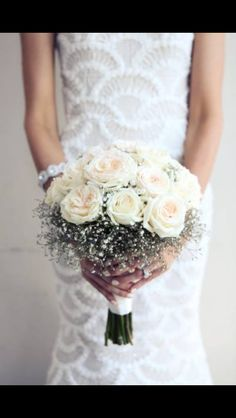 Bridesmaids bouquets - white roses/peonies surrounded by gypsophilia