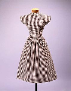 Dress  Claire McCardell  (American, 1905–1958)  Manufacturer: Townley Frocks (American) Date: 1943 Culture: American Medium: cotton Dimensions: Length: 43 1/2 in. (110.5 cm) Credit Line: Gift of Claire McCardell, 1949
