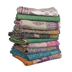 Vintage handmade Kantha Quilts! Each one is made by stitching together 5 vintage saris on top of each other. Imagine each unique combination of color and pattern!     via niki-jones.co.uk