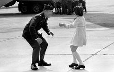 """""""March 17, 1973: Heidi Hess, 9, runs to greet her father, Air Force Maj. Jay C. Hess, at March Air Force Base following his release by the North Vietnamese. Hess was a prisoner of war for more than five years after enemy fire"""" downed his F-105 bomber."""