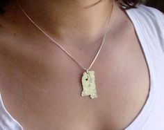 I would LOVE this Mississippi necklace by Etsy artist ShopOhSoAntsy. She will let you custom place the heart, so I would move it to Columbus to remind me of my amazing MUW. =]