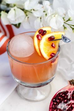 The refreshingly bright flavors of Pomegranate and orange fuse perfectly in this pomegranate and orange cocktail creating a fruity, yet sassy drink perfect for holiday parties. http://fancyshanty.com/pomegranate-and-orange-cocktail/