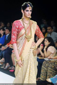 A model walks the ramp to showcase a creation by jewellery designers Dhora and Rivaayat during the India International Jewellery Week (IIJW), held at Grand Hyatt, Mumbai, on August 07, 2013