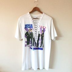 Lace-Up❣NKOTB Vintage Tee Authentic vintage New Kids on the Block concert tee from 1989! Soft and thin material. Graphics front and back. Altered with white twill tape, silver grommets and laced down the center with thin twill. One of a kind!  BRAND: Hanes MATERIAL: 50/50 YEAR/ERA: 1989 LABEL SIZE: L BEST FIT: S/M/L depending on desired look  MEASUREMENTS: Bust 20 inches Length 29 inches  *Listed as LF for views. *Price firm unless bundled.  ☠ No trades please!  Check out my closet for more…
