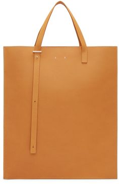 Structured vegetable-tanned leather tote in tan. Adjustable double carry handles with post-stud fastening at bag throat in tan. Leather drawstring closure at bag throat. Zippered pocket in grey suede at interior. Silver-tone hardware. Tonal stitching. Approx. 13