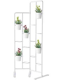 En la pared o en un soporte como éste que, además, puede servir para separar ambientes a modo de bio... - Copyright © 2015 Hearst Magazines, S.L.