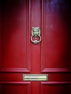 Pretty front door with classic lion door knocker and mail slot...
