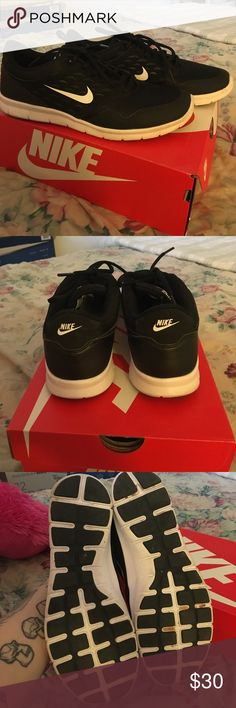 Women's Black Nikes Good condition. Some markings as shown in photos. Right shoe has a loose eyelet as shown above. Nike Shoes Sneakers
