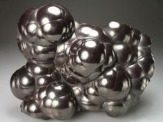 Hematite - It grounds and protects us. Dissolves negativity and prevents you from absorbing the negativity of others.  It is strong, supporting timidity, boosting self-esteem and survivability, enhancing willpower and reliability, and imparting confidence.  It helps to overcome compulsions and addictions, treating overeating, smoking and other forms of overindulgence.