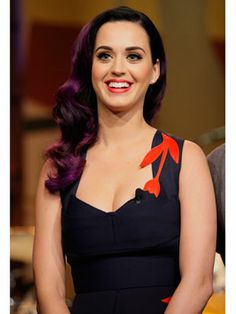 Famous Singer And Songwriter Katy Perry.  Wow, she actually looks normal here :)  I do like some of her songs though.  Grrrrl power!!