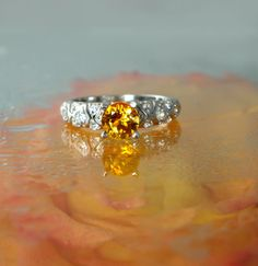 citrine + white topaz - I could afford this too! I might just have to get this!! I like alot!