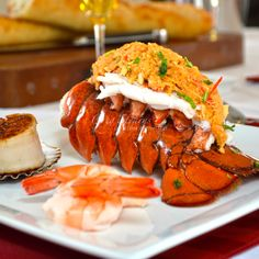 Snowcrab stuffed Maine lobster tail with pan seared scallop and shrimp.