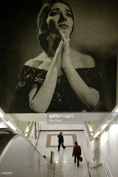 Athenians walk under a picture of opera singer Maria Callas at the Megaron subway station in Athens, Greece, Monday, March 28, 2005.