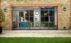 Keen to extend their house in Wandsworth, South West London, to create a large, light filled family kitchen and dining area opening directly onto the garden, Simon and Marissa Pilkington used a scr… 1930s House Extension, Extension Designs, Rear Extension, Extension Ideas, Steel Windows, Windows And Doors, Industrial Living, Industrial Style, Industrial Windows