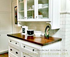 A white kitchen (with subway tile, wood counters and old world character, on a budget)