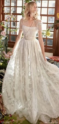 Ivory and silver brocade ballgown with a corset top and a voluminous pleated skirt.