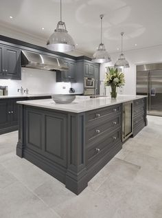 This luxury grey painted kitchen features a statement island perfect for any gathering, complete with the latest in Wolf appliances.