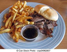 A roast beef sandwich on a toasted bun, served with French fries and au jus for dipping.