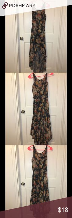 Floral Dress Black with multi color flowers. Hi low design. See through on top but liner for the bottom. Dresses High Low