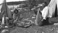 Indian man and woman mending net, Lake of the Woods. Creator: Carl Gustaf Linde. Photograph Collection, 1922. Visual Resources Database. Minnesota Historical Society