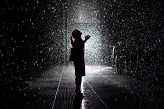 """A visitor of the installation """"Rain Room"""" at The Museum of Modern Art (MoMA) is seen on May 20, 2013. The exhibit is part the EXPO 1: New Yo..."""