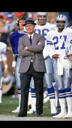 Tom Landry.Steve Pelluer,Kevin Brooks ,Ron Fellows,Bill Bates can be seen in background
