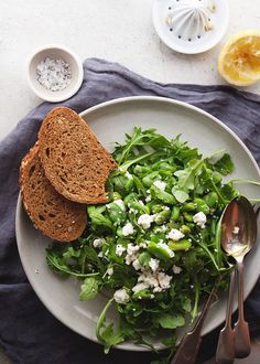 arugula, edamame, goat cheese salad with lemon juice and pumpernickel bread