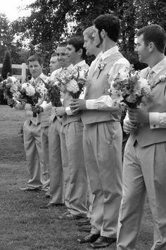 Groomsmen holding flowers. Funny wedding photo!