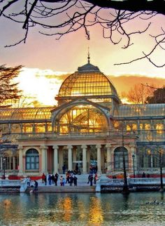 Setting sunlight shines through the Crystal Palace in Madrid, Spain