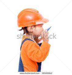 Asian Engineer baby girl with pen in hand thinking for write something - stock photo