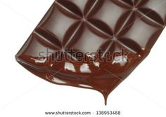 Melting chocolate dripping on white background. You can dowload this image from Shutterstock in high resolution