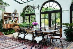Sunroom rugs on chairs hanging plants