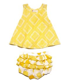 <p+style='margin-bottom:0px;'>Rear+ruffles+on+these+bloomers+love+playing+peekaboo+when+paired+with+this+darling+dress.+Both+slip+on+simply+thanks+to+the+shoulder+snaps+and+an+elastic+waistband+for+a+look+as+cool+as+the+ocean+breeze.<p+style='margin-bottom:0px;'><li+style='margin-bottom:0px;'>Includes+jumper+and+diaper+cover<li+style='margin-bottom:0px;'>100%+cotton<li+style='margin-bottom:0px;'>Machine+wash;+hang+dry<li+style='margin-bottom:0px;'>Made+in+India<br+/>