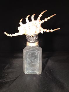 Small frosted bottle with spiney shell hand soldered.