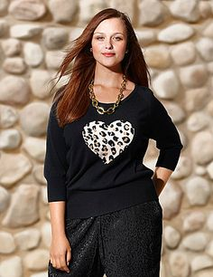 Fun & fashionable graphic sweater sweetens the season with an animal heart motif and subtle studded accents. This figure-flattering sweater is detailed with a charming scoop neck and a wide, ribbed hem to hug your curves just right. Finished with 3/4 sleeves with ribbed cuffs. Lusciously soft and cozy in a medium weight knit for anytime comfort. lanebryant.com
