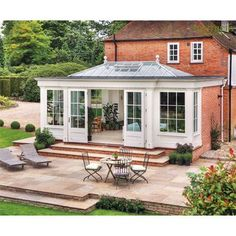 Bespoke Wooden Orangeries Garden room extension with french doors leading onto patio area Garden Room Extensions, House Extensions, House Extension Design, House Design, Orangery Extension, Westbury Gardens, Roof Lantern, Backyard Patio, Architecture