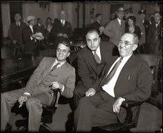 Al Capone, center, in federal court in Chicago during his 1931 tax-evasion trial, with lawyers Michael Ahern, left and Albert Fink. — Chicago Tribune historical photo, May 10, 2013