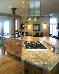 Having the stove top on the island makes it easy and fun to cook and converse with your dinner guests!