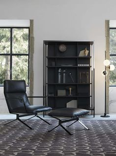 Trussardi Casa - Sit 414 armchair and footstool, Bridge bookshelf and Greyhound rug www.luxurylivinggroup.com #Trussardi #LuxuryLivingGroup