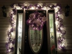 Lighted purple and white, christmas, deco mesh door decor now who's name is wrote on these colours. Purple Christmas Decorations, Purple Christmas Tree, Christmas Lights, Christmas Time, Christmas Garlands, White Christmas, Deco Mesh Garland, Deco Mesh Wreaths, Christmas Door Decorating Contest