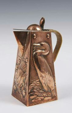 Arts & Crafts Newlyn School copper water jug, embossed with cormorant and fish, wicker handle.